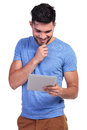 Smiling man is reading interesting stuff on his tablet pad Royalty Free Stock Photo