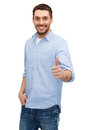 Smiling man showing thumbs up happiness gesture and people concept Stock Photography