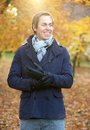Smiling man standing outdoors in jacket scarf and gloves portrait of a Stock Photography