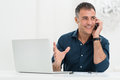 Smiling Man Talking On Cellphone Royalty Free Stock Photo