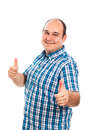 Smiling man thumbs up gesturing isolated on white background Stock Image