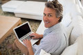 Smiling man using laptop in living room Royalty Free Stock Photo