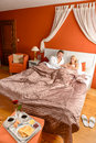 Smiling man woman hotel bed relaxing breakfast Royalty Free Stock Image