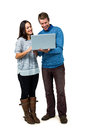 Smiling man and woman using laptop men women against white background Stock Photography