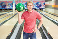 Smiling man young attractive in bowling Royalty Free Stock Images