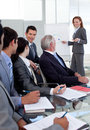Smiling manager giving a presentation to her team Royalty Free Stock Photo