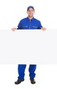 Smiling manual worker with billboard Royalty Free Stock Photo