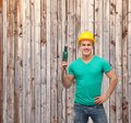 Smiling manual worker in helmet with drill machine repair construction and maintenance concept male protective Royalty Free Stock Photography