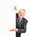 Smiling mature businessman holding a white panel Stock Images
