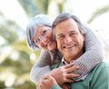 Smiling mature couple together in the park Royalty Free Stock Image