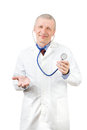 Smiling mature doctor with phonendoscope isolated on white Royalty Free Stock Photography