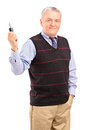 Smiling mature gentleman holding a car key Stock Photography