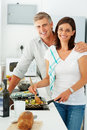 Smiling mature preparing food together at home Stock Photography