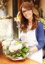 Smiling mature woman florist small business flower shop owner shallow focus Royalty Free Stock Photos