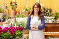 Smiling mature woman florist small business flower shop owner shallow focus Royalty Free Stock Image