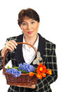 Smiling mature woman holding basket Royalty Free Stock Image