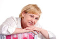 Smiling mature woman over white background Royalty Free Stock Photography
