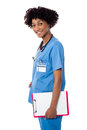 Smiling medical professional holding blank clipboard Stock Photography