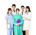 Smiling medical team standing together isolated on white asian Royalty Free Stock Photos