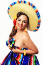 Smiling mexican pin up girl a happy senorita covering herself with a blanket isolated on white background Royalty Free Stock Image