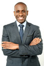 Smiling middle aged business executive handsome african businessman with arms crossed Stock Images
