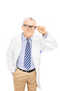Smiling middle aged doctor with glasses isolated on white background Stock Photo