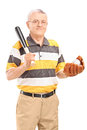 Smiling middle aged man holding a wooden baseball bat and glove with ball in it isolated on white background Royalty Free Stock Photos