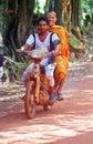 Smiling Monk on Motorbike - Cambodia