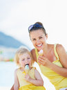 Smiling mother and baby eating ice cream Royalty Free Stock Photo