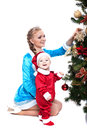 Smiling mother and baby posing in xmas costumes isolated on white Royalty Free Stock Photography