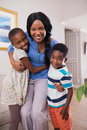 Smiling mother with children at home Royalty Free Stock Photo