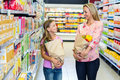 Smiling mother and daughter with grocery bags Royalty Free Stock Photo