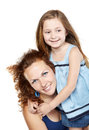 Smiling mother holds daughter in arms Stock Images