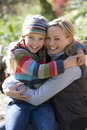 Smiling mother hugging daughter outdoors Royalty Free Stock Photography