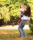 Smiling mother and little daughter on nature happy people outdoors Stock Photography
