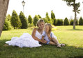Smiling mother and little daughter on nature happy people outdoors in white clouse Royalty Free Stock Photography