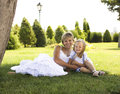 Smiling mother and little daughter on nature happy people outdoors in white clouse Royalty Free Stock Images