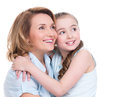 Smiling mother and young daughter looking up isolated happy family people concept Stock Photo