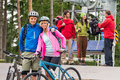 Smiling mountain bikes couple hikers waiting chair lift trip Stock Photo