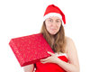 Smiling mrs claus with gift young red Royalty Free Stock Images