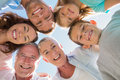 Smiling multi generation family down at the camera Royalty Free Stock Images