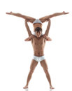 Smiling muscular acrobat holds partner isolated on white Royalty Free Stock Photography