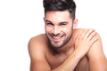 Smiling naked man with hand on his shoulder closeup picture of a white background Royalty Free Stock Photo