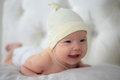 Smiling new borng baby in yellow hat Stock Photos
