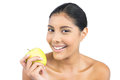 Smiling nude brunette holding green apple on white background Stock Photo