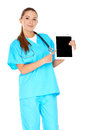 Smiling nurse pointing to a tablet pc beautiful young doctor or computer that she is holding in her hand with the screen visible Stock Photo