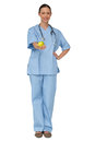 Smiling nurse in scrubs holding green apple Royalty Free Stock Photo