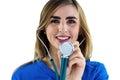 Smiling nurse using stethoscope Royalty Free Stock Photo