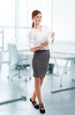 Smiling office lady with notebook at work Royalty Free Stock Photo