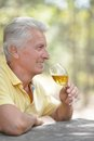 Smiling old man drinking wine Royalty Free Stock Photo